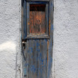 Old grungy door in Santorini, Greece — Stock Photo
