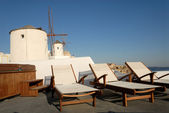 Sunlounger at the terrace in Santorini, Greece — Stock Photo