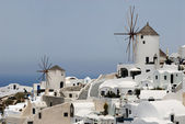 Two traditional windmills in Oia, island Santorini Greece — Stock Photo