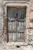 Old grungy door in Santorini, Greece — Stock Photo