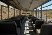 Inside of an abandoned bus — Stock Photo