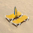 Stock Photo: Sunlounger on beach