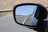 Road in rear view mirror, Fuerteventura Spain — Stock Photo