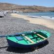 Stock Photo: Fishing boat on beach of Pozo Negro, Fuerteventura, Spain