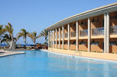 Luxury hotel with swimming pool in a summer resort — Foto de Stock