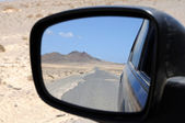 View in the rear mirror — Stock Photo