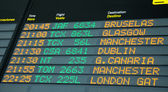 Shedule board of an airport with some flilghts to United Kingdom — Stock Photo