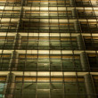 Royalty-Free Stock Photo: Modern Office Building Facade illuminated at Night