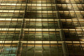 Modern Office Building Facade illuminated at Night — Stock Photo
