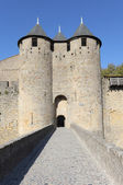 Fortified gate to the medieval town of Carcassonne, France — Stock Photo