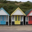 Bathing boxes at the Beach in England - Stock Photo