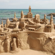 Amazing sandcastle on a mediterranean beach - Stock Photo