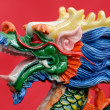 Chinese dragon against red background - Stock Photo