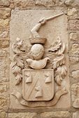 Medieval emblem in the Castle of Alicante — Stock Photo