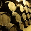 Stock Photo: Old wine cellar full of wooden barrels