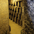 Stock Photo: Wooden barrels in old wine cellar