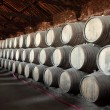 Old wine cellar full of wooden barrels — Stock Photo #7575079