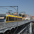Metro on Dom Luis I Bridge in Porto, Portugal — Stock Photo #7578541