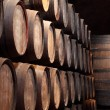 Old wine cellar full of wooden barrels - Stock Photo