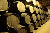Old wine cellar full of wooden barrels — Stock Photo