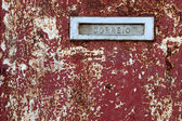 Mail box slot on the old grungy door in Portugal — Stock Photo