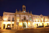 Building illuminated at night in the old town of Faro, Portugal — Stock Photo