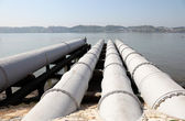 Sewage system over the river water — Stock Photo