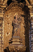 Madonna statue in a gilded altar — Stock Photo
