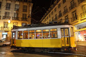 Old tram in the city of Lisbon at night — Stock Photo