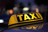 Taxi sign at night — Stock Photo