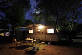 European mobile home on a camping site at night. — Stock Photo