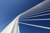 Modern bridge pylon against a blue sky — Stock Photo