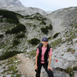 Female hiker in the alps. — Stock Photo