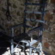 Torture chair in old German castle - Stock Photo