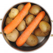 Cooking pot with carrots and potatoes — Stock Photo