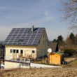 House with solar panels on the roof — Stock Photo #7796755