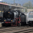 Stock Photo: Old and New. Steam train at Train Station