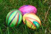 Colorful easter eggs in green grass — Stock Photo
