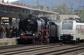 Old and New. Steam train at Train Station — Stock Photo