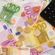 Euro money background with notes, coins and calculator — Stock Photo