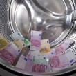Money laundering in washing machine — Stock Photo #7878348