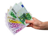 Hand with Euro notes isolated over white background — Stock Photo