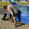 Changing a tire on the road — Stock Photo