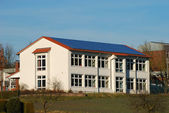 Building with solar panels on the roof — Stock Photo