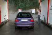 Woman washing her car — Stock Photo
