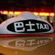 Taxi sign at night in Shanghai, China - Stock Photo