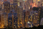 Aerial view over highrise buildings at night — ストック写真