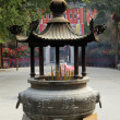 Incense burner at Buddhist Temple in Hong Kong - Stock Photo