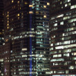 Stock Photo: Highrise modern building at night