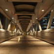 Pedestrian Bridge in the city of Hong Kong at night - Foto Stock